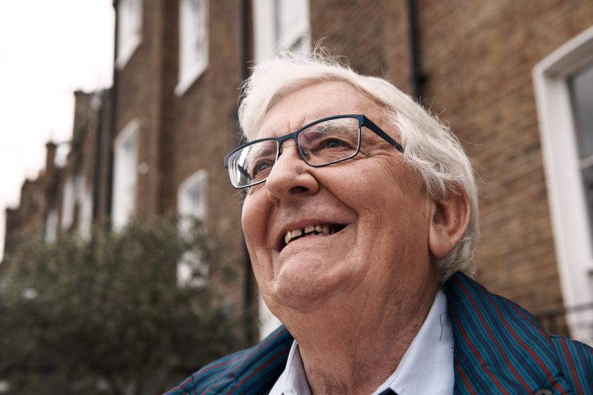 Guild Living: Man smiling outside