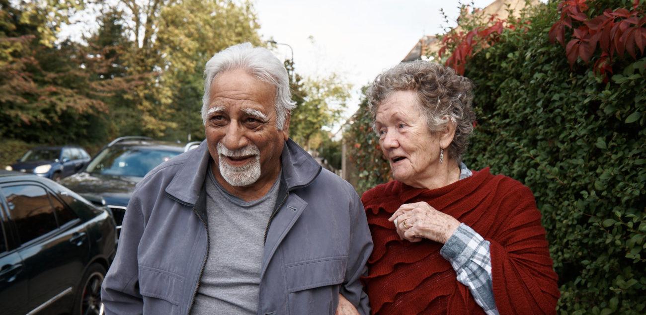 Guild living later ivign social care reform Older couple walking in street