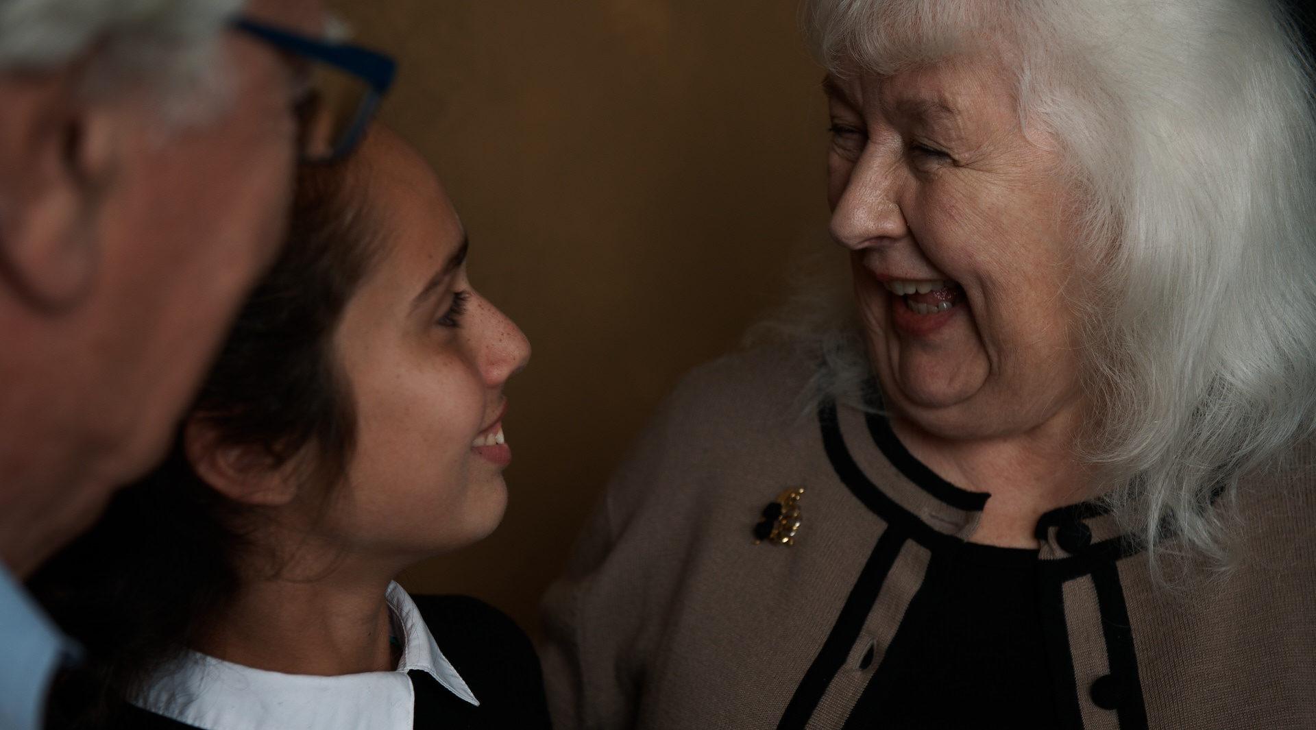 Guild Living Alliance Framework - Grandparents and grandchild smiling