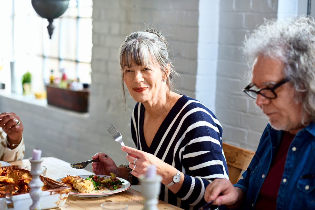 Guild Living_woman enjoying healthy lunch with friends
